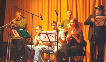 Our first gig at the Colliers Wood Ukulele Festival May 2010 - (L to R) Chris, Rufus, Simon, James, Julia & Andy