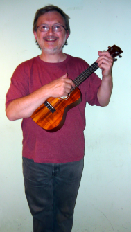 Andrew with one of his many ukuleles