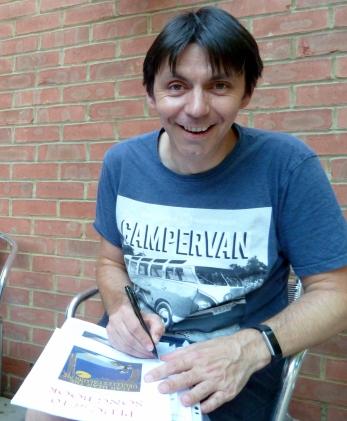 PLUC10 Simon Autographing Songbooks